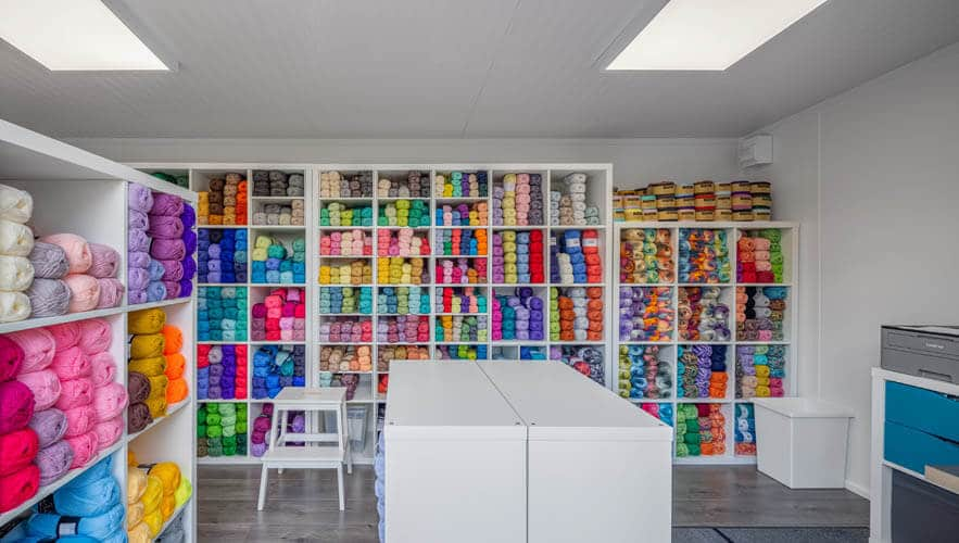 Room with shelves of colourful yarn