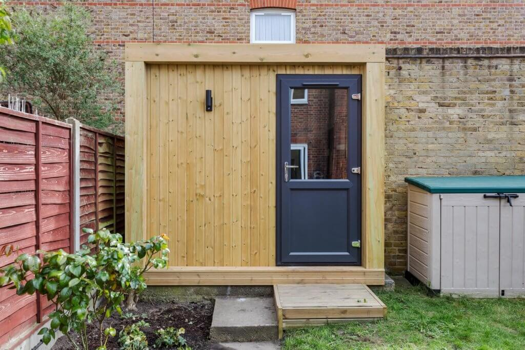 small garden room with single door