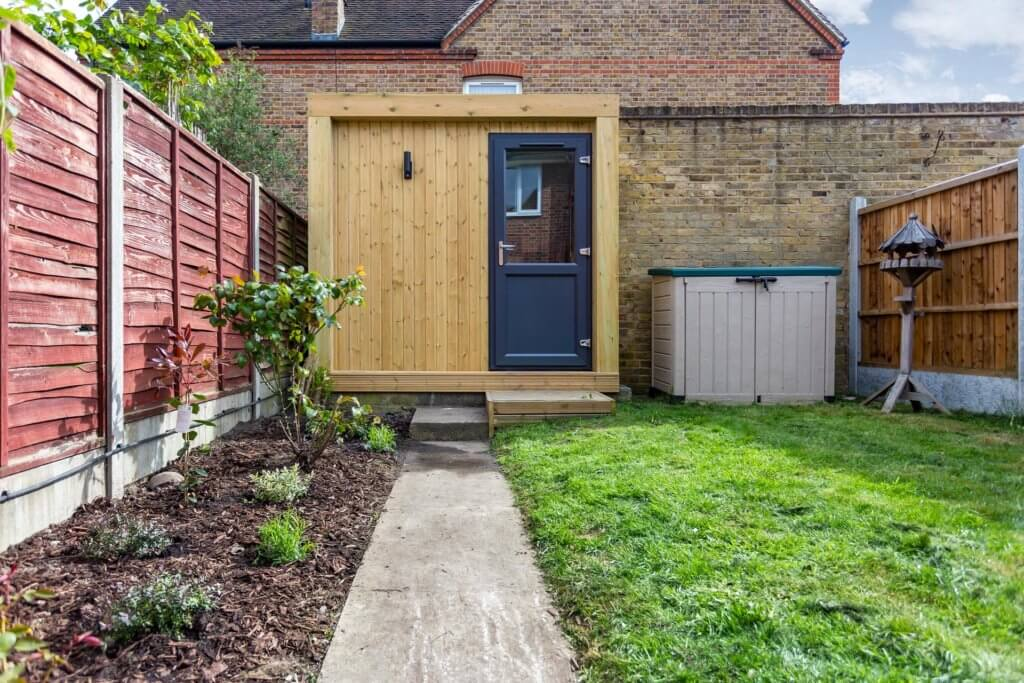 small garden room in the corner