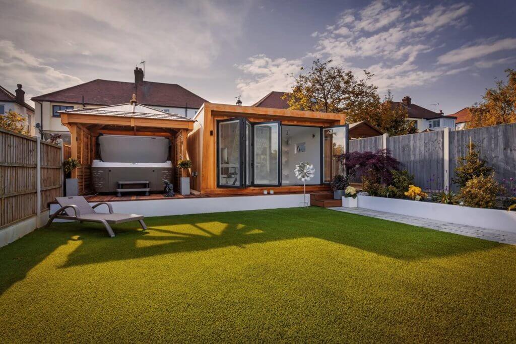 Garden room with hot tub and doors open
