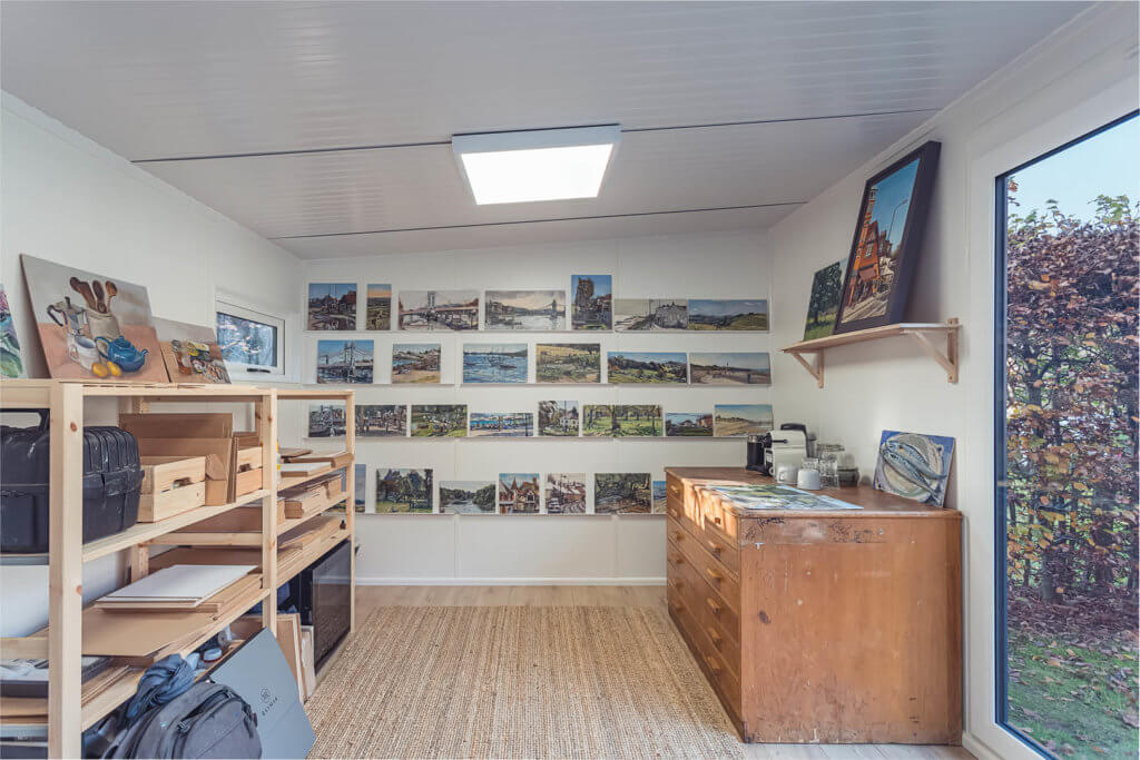 artist studio with drawers and shelves and paintings