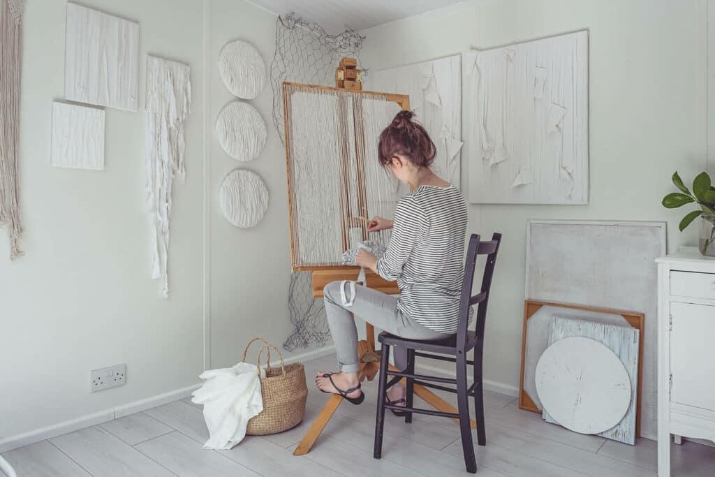 Artist Saskia Saunders in her garden room art studio