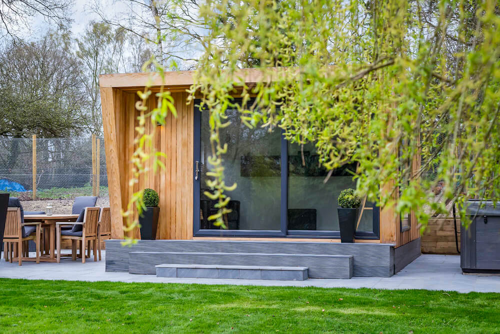 beautiful garden room in a large garden with trees
