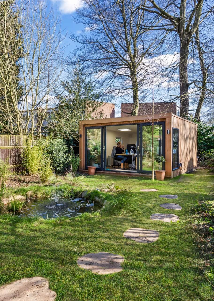garden office in rustic wooded garden