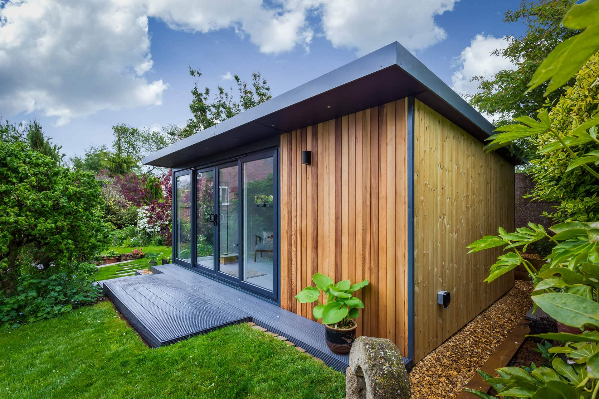 Side angle view of Expression garden room with graphite escking