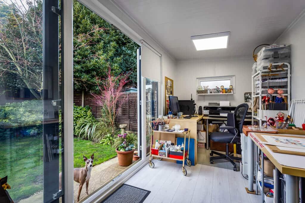 large sliding door on garden art studio