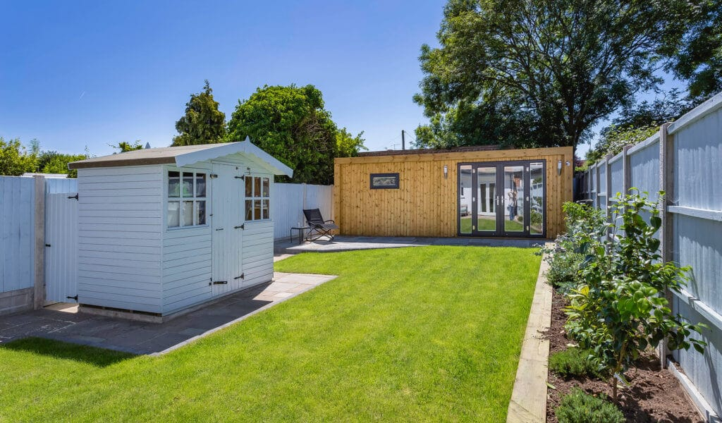 modern summer garden with garden room and shed