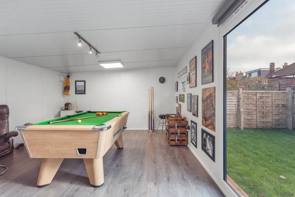 Pool table with storage and pool cues