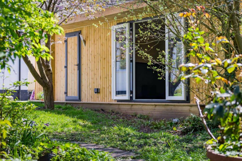 Scandinavian redwood garden room with large opening doors
