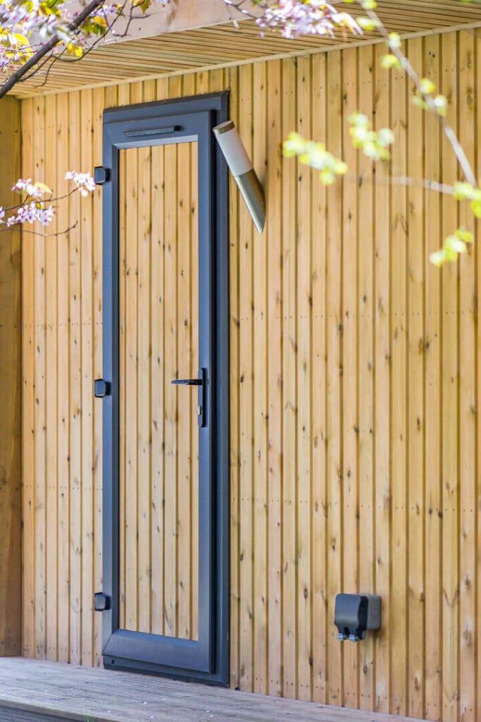 Garden room with fully clad single door, external socket, outside light