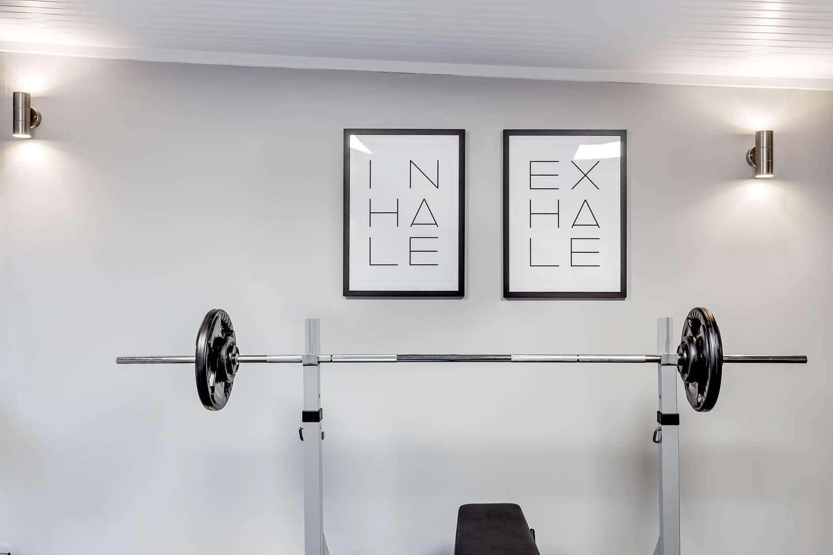 Pictures on wall in home gym