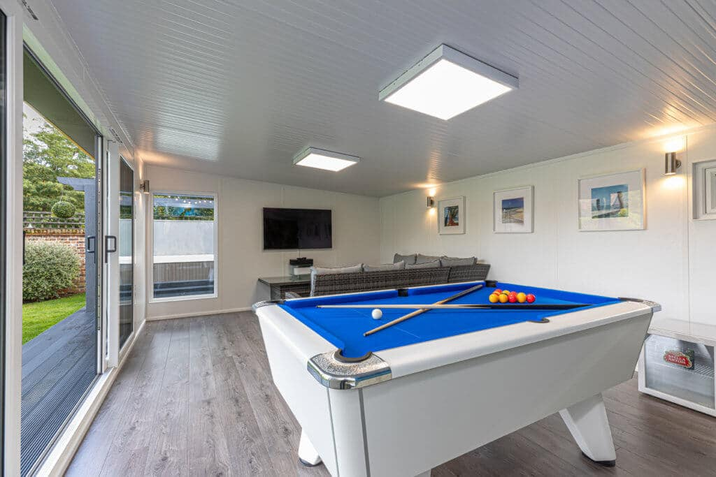 Interior of an Edge with a snooker table and island mural