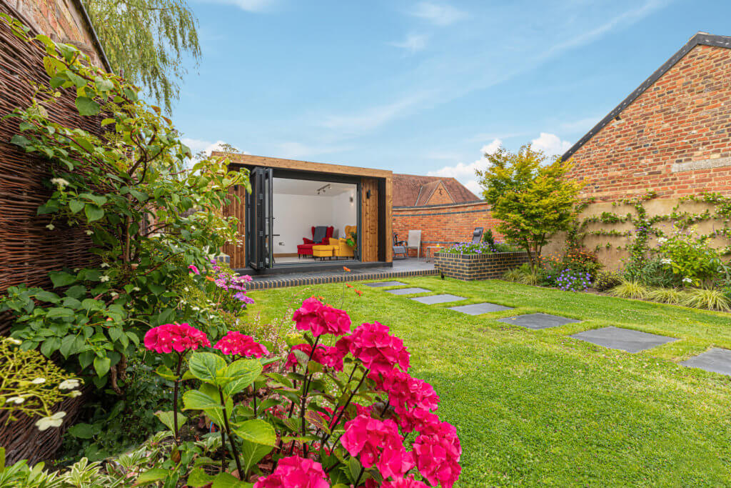 modern garden office in traditional garden