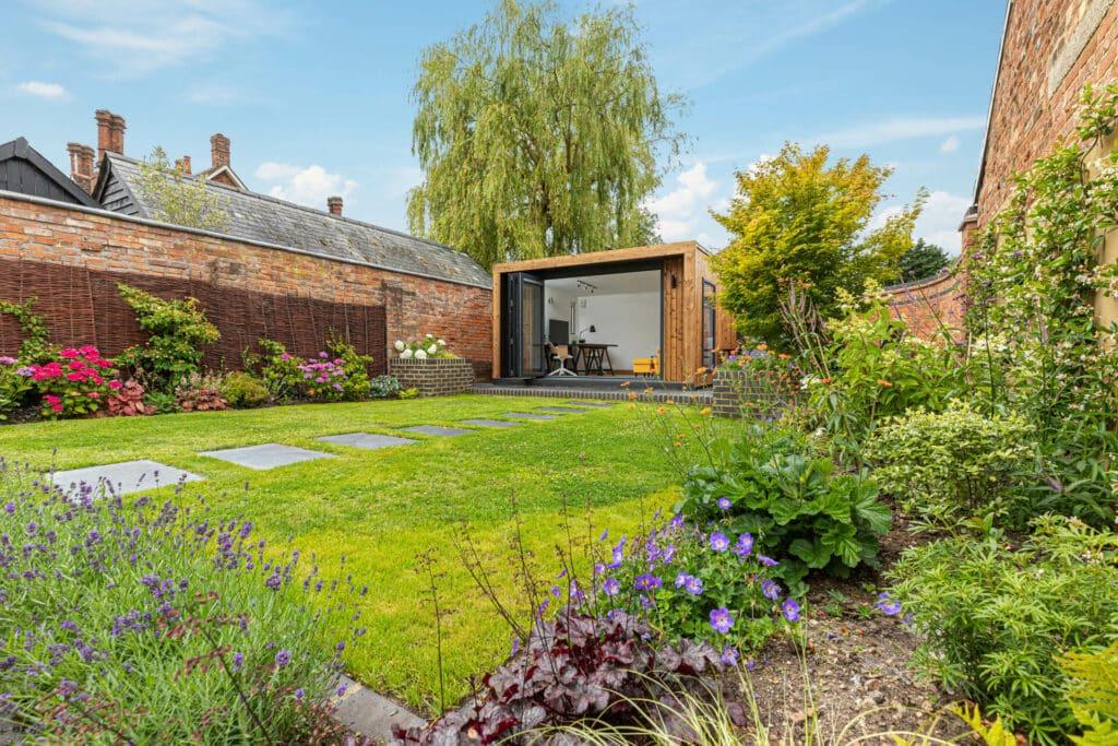 Rustic garden with modern garden room