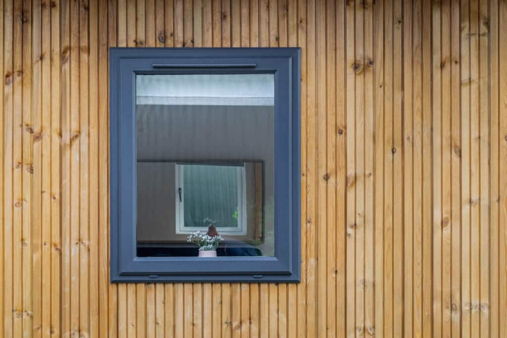 Closed escape window and slated redwood cladding