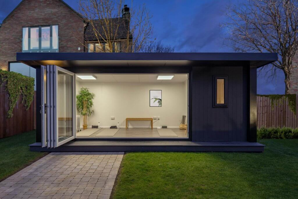 composite black garden building with bi folding doors