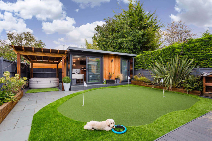 Garden room office with golf putting green in front