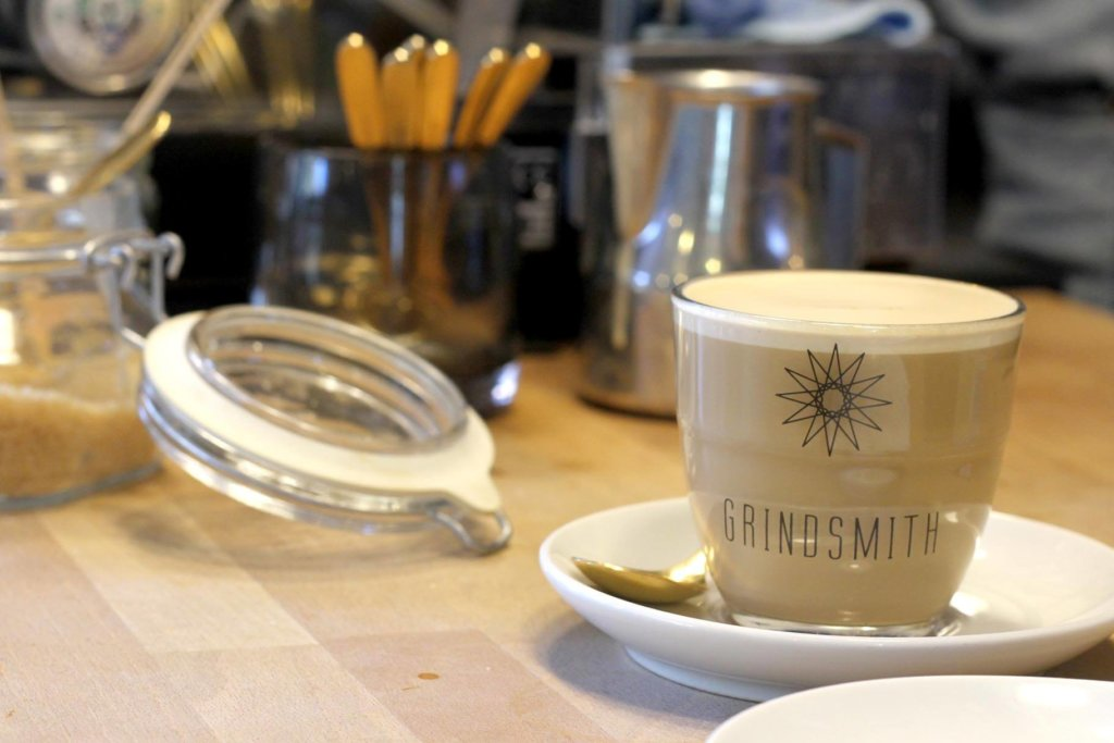 grindsmith latte on table