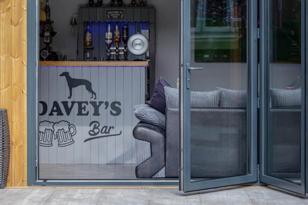 Exterior of Inspiration looking into man cave with bar