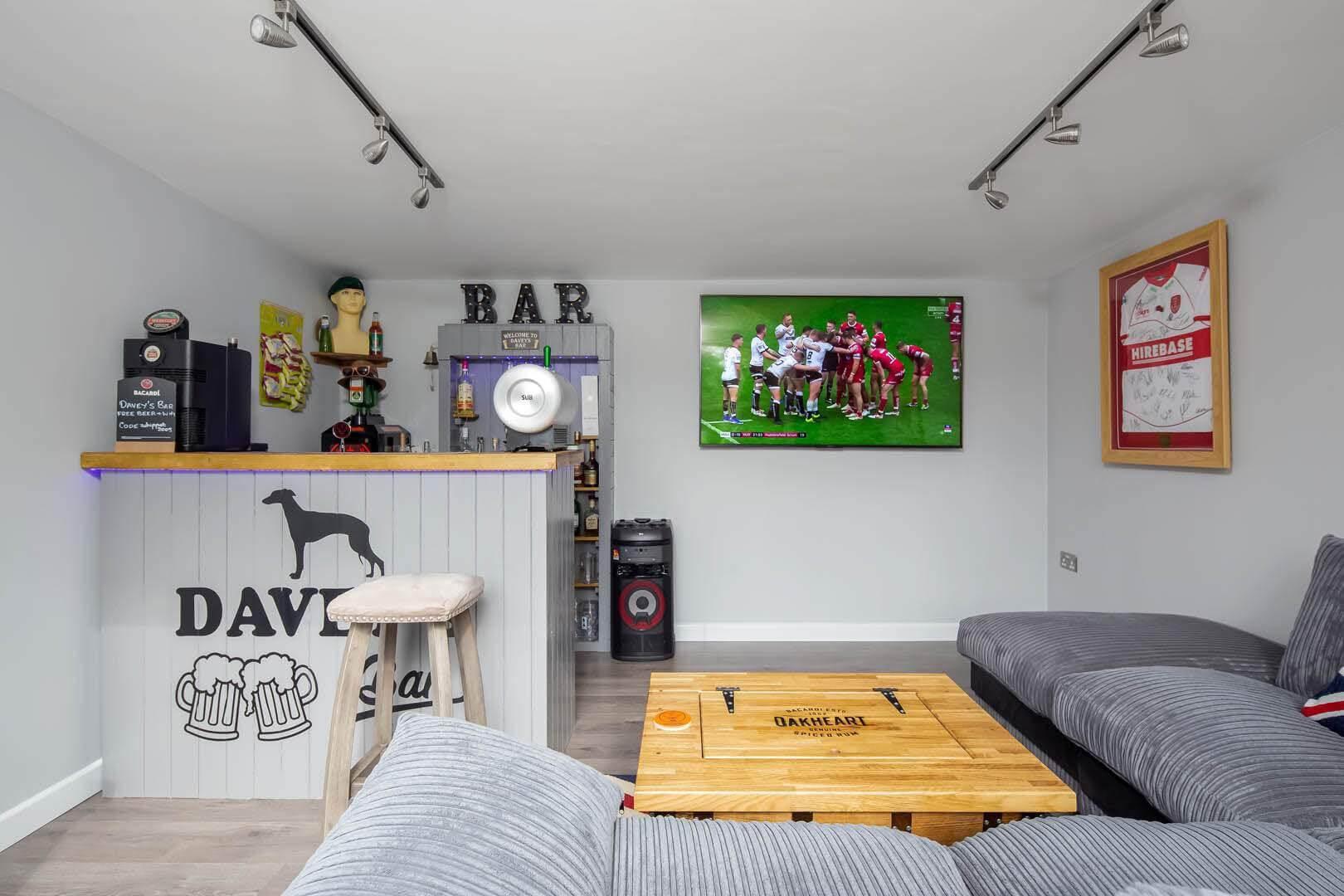 garden bar interior with bar and tv