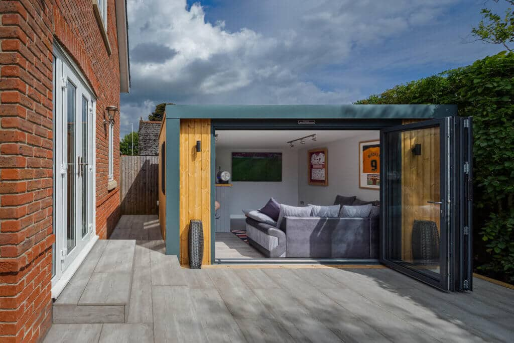 Exterior of Inspiration with bi-folds open looking into man cave