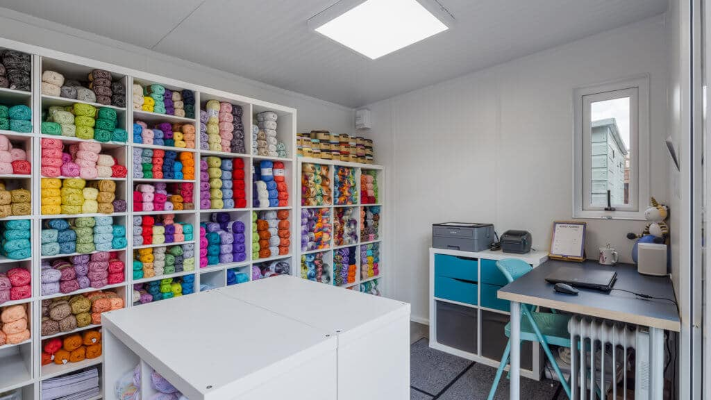 Interior home office being used as a yarn business with shelves of colourful yarn inside