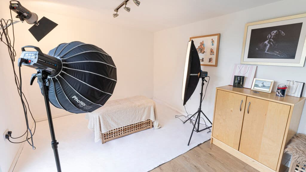 Interior of Inspiration photography studio with spot lights pointing towards a bench