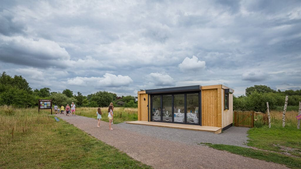 Exterior of an Inspiration used as RSPB welcome hub with children walking by