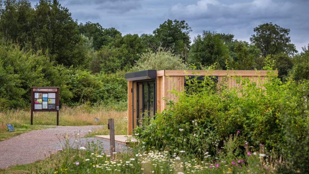 Exterior of an Inspiration used as RSPB welcome hub with bushes in the foreground