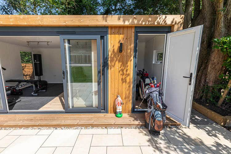 Section of garden room with french doors open and small storage door on the right open with golf clubs