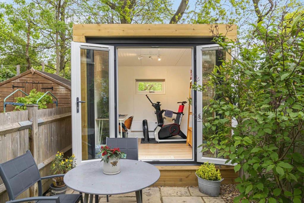 Exterior of a garden office with the doors open
