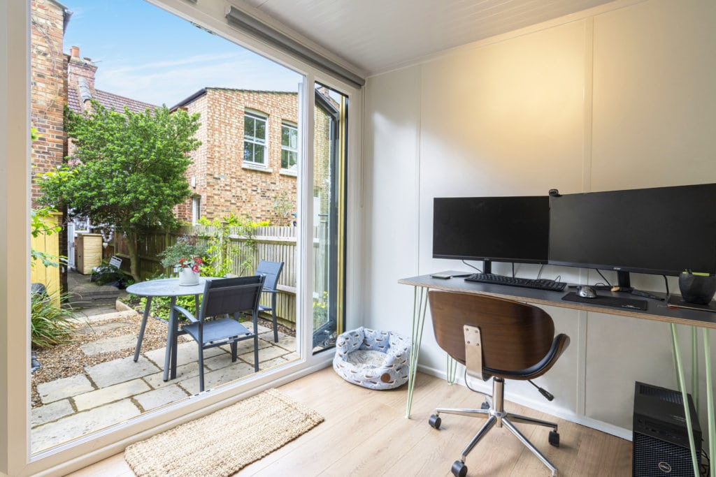 Interior of a garden office with a desk and chair