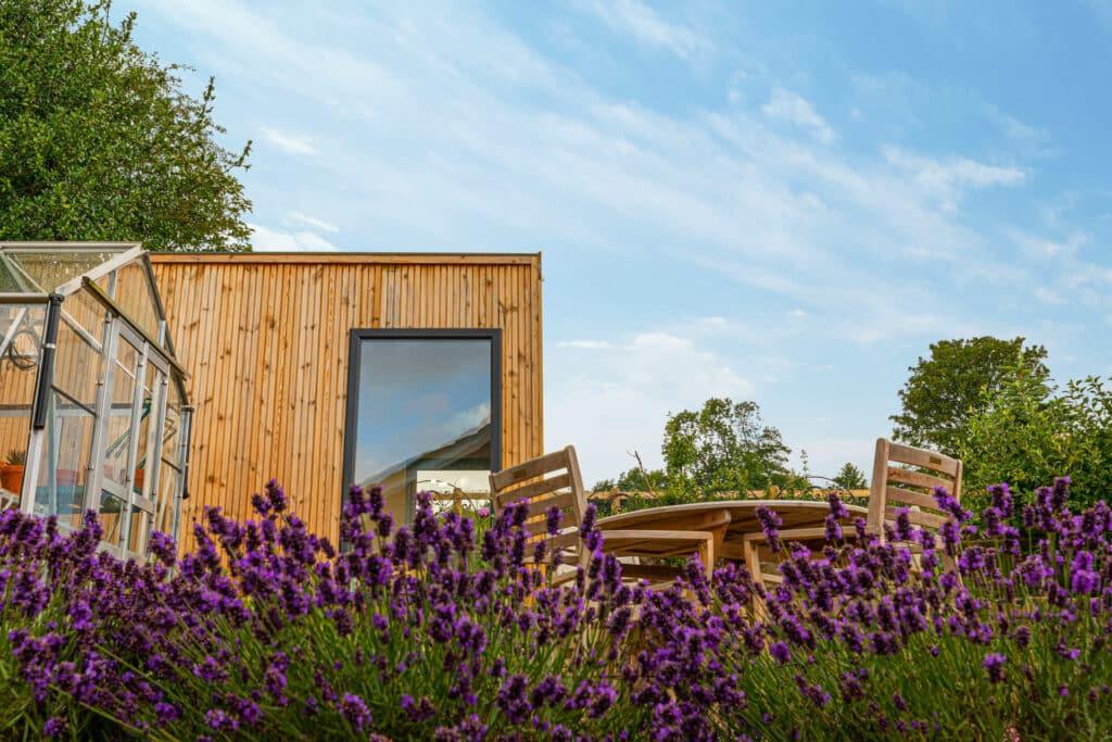 English garden with modern garden room