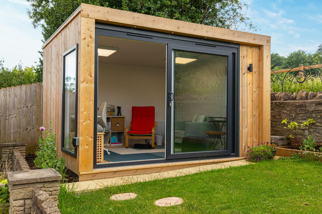 compact garden room for writing and art