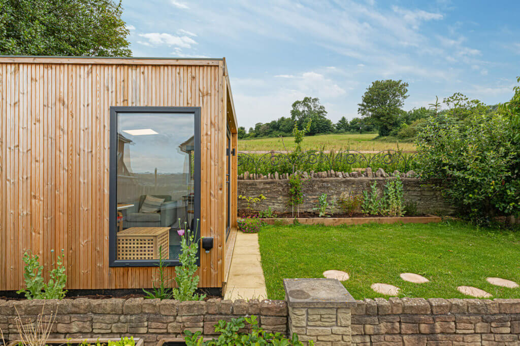 modern compact garden room with slatted cladding