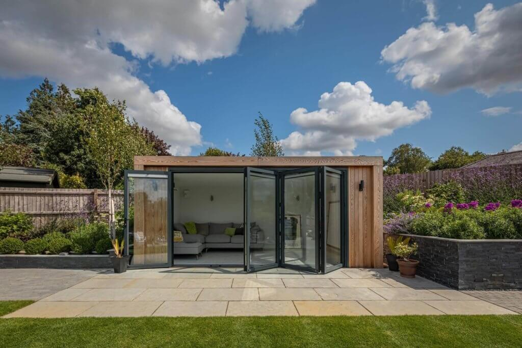 garden cinema room with bi-fold doors
