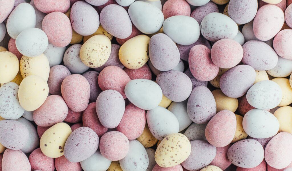 mini eggs all on background