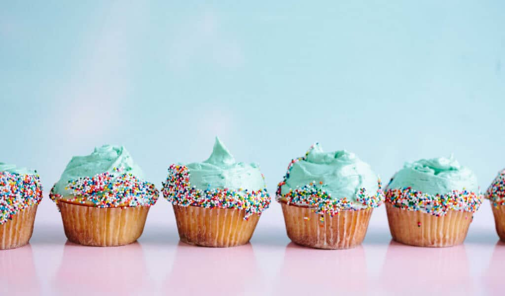 cupcakes with blue icing and millions