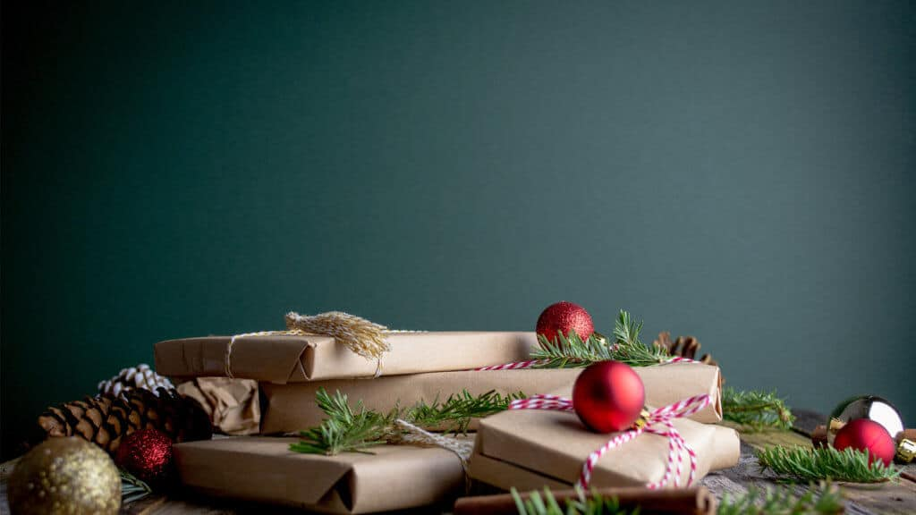 Christmas presents wrapped in kraft paper with baubles