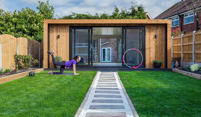 woman exercising in front of garden gym