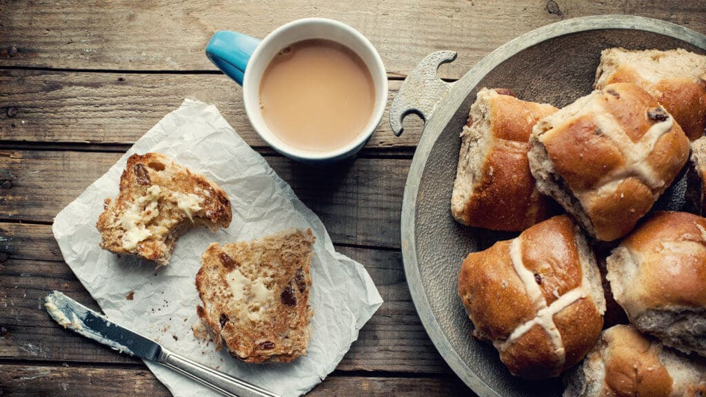 Fresh hot cross buns with a cup of tea
