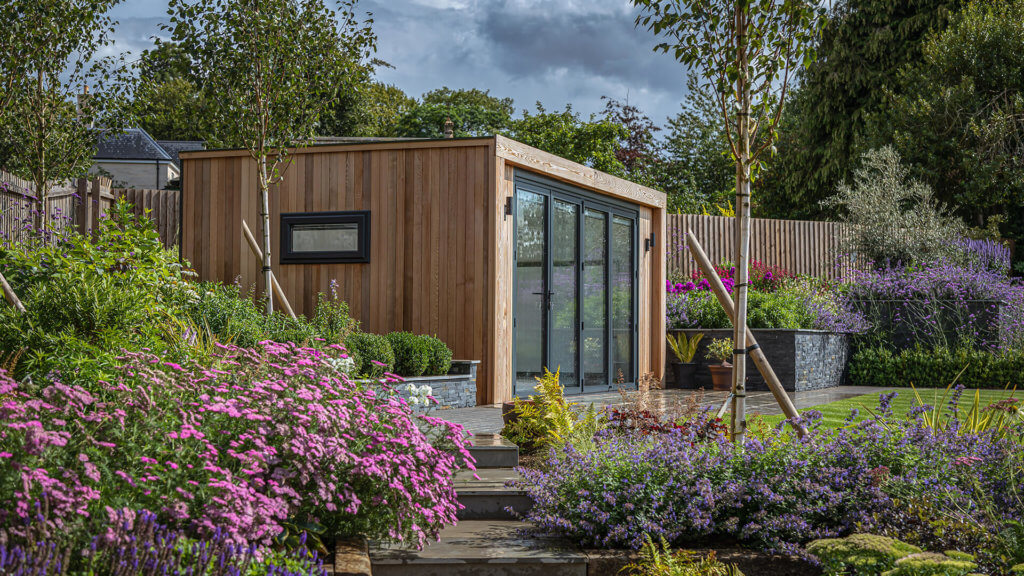 Exterior of a garden room in a beautifully blooming garden