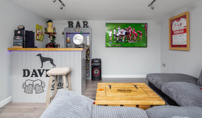 man cave with bar and tv