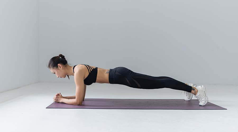 woman planking doing yoga