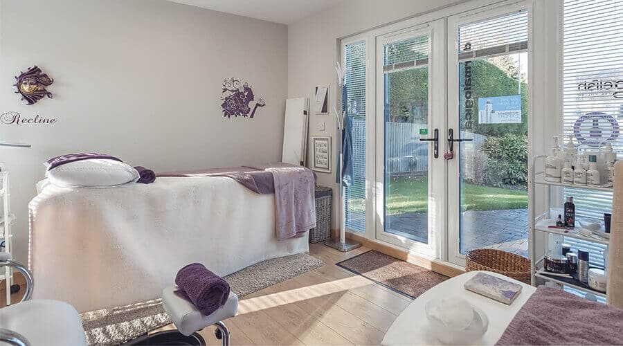 purple salon with bed and products