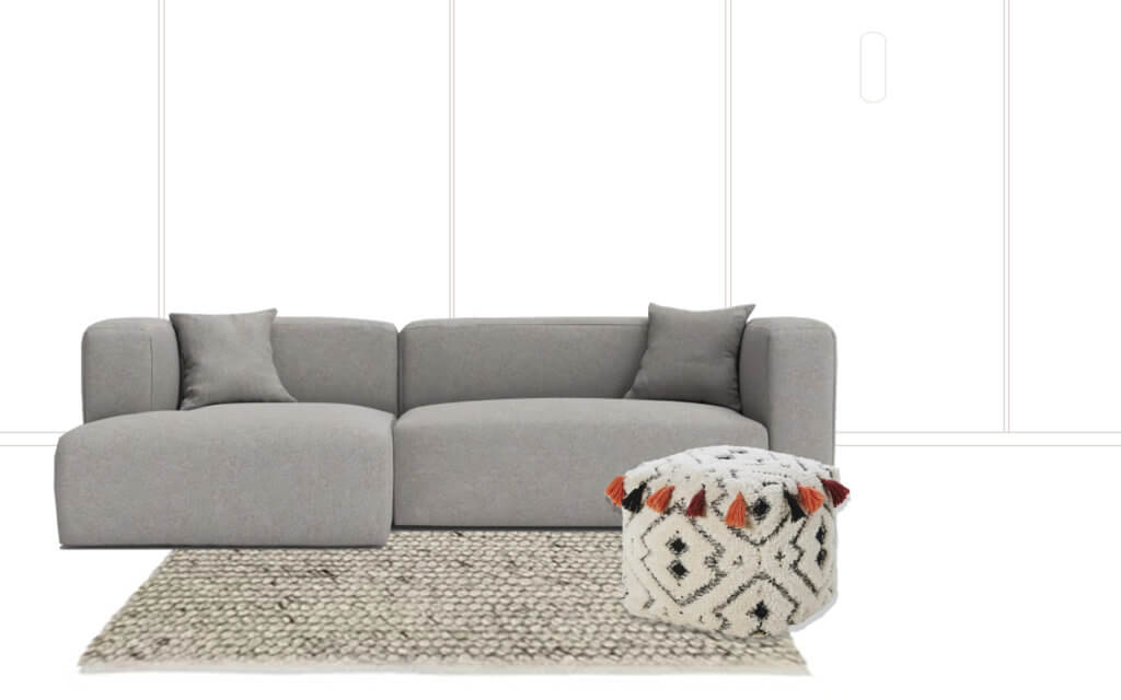 room with grey sofa, pouffe with tassels and natural rug