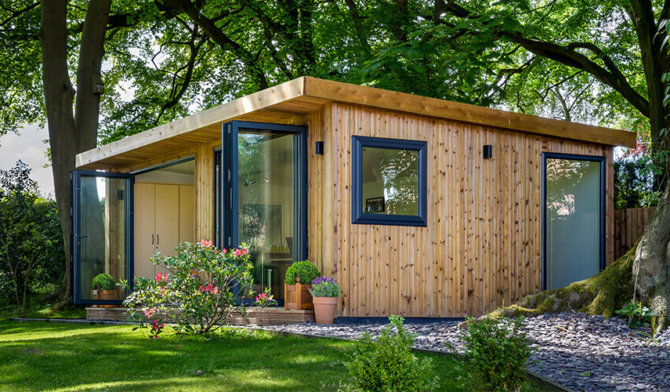 Garden room with doors open during Spring