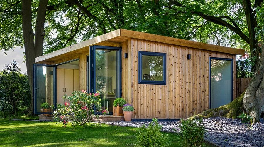 Garden room with doors open during Spring